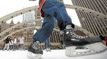 Skaters take to the ice at Nathan Phillips Square in Toronto Tuesday, January 4, 2011. (Darren Calabrese for The Globe and Mail/Darren Calabrese for The Globe and Mail)