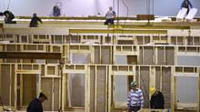 Construction tradesmen build portable housing for oil sands workers at the ATCO Structures facility in Calgary last February. In the resource-rich West, workers are benefiting from the commodities boom and a scramble by companies to attract skilled labour. (Jeff McIntosh For The Globe and Mail)