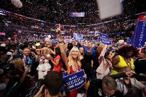 Delegates stand and cheer at the end of the Republican National Convention on July 21, 2016, at the Quicken Loans Arena in Cleveland, Ohio.