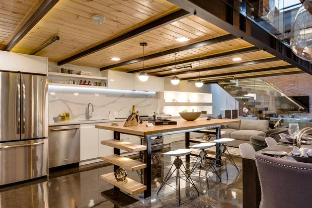 The loft features quartz countertops in the kitchen.