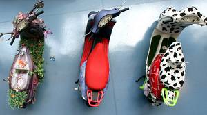 If you're going for a masculing look, we suggest avoiding these Vespas, as displayed at the Piaggio Museum during Vespa's 60th anniversary celebrations in Pontedera, near Pisa, northern Italy.