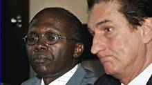 Léon Mugesera, left, and lawyer Guy Bertrand ponder questions of a news conference on June 29, 2005 in Quebec City. (Jacques Boissinot/The Canadian Press/Jacques Boissinot/The Canadian Press)