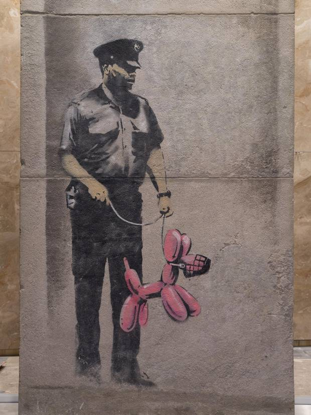 This Banksy piece was reassembled and installed in the PATH network at 1 York St.