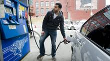Mostafa Mahmood puts gas in his car Wednesday in Montreal. Prices rose across Canada, and analysts are pointing to speculation as the cause. (Graham Hughes for The Globe and Mail/Graham Hughes for The Globe and Mail)