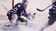 Toronto Maple Leaf goalie James Reimer (34) makes a save during second period NHL play against the Minnesota Wild Oct 15, 2013 in Toronto. (Moe Doiron/The Globe and Mail)