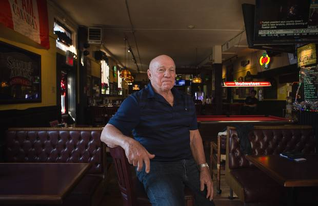 Bobby Taylor, the former CFL player and hockey player now runs the Black Bull in Toronto. He is photographed in the bar on November 25, 2015.