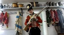 A program officer at Fort York leads a tour the Toronto historic site, which was key outpost in the War of 1812. (Peter Power/Peter Power/The Globe and Mail)