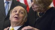 Former White House press secretary James Brady, left, who was left paralyzed in the Reagan assassination attempt, looking at his wife Sarah Brady. A Brady family spokeswoman says Brady has died at 73. (AP Photo/Evan Vucci) (Evan Vucci/Associated Press)