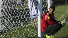 Julio Cesar takes a break from practice with the Team Brazil on June 4. (REUTERS)