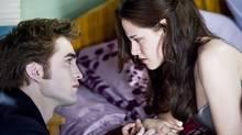 Robert Pattinson as Edward Cullen and Kristen Stewart as Bella Swan in The Twilight Saga: New Moon. (Kimberley French)