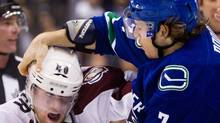 The Vancouver Canucks' David Booth tries to get the helmet off the head of the Colorado Avalanche's Mark Olver. (Darryl Dyck/The Canadian Press/Darryl Dyck/The Canadian Press)