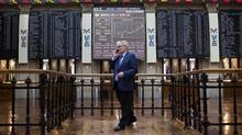 A visitor stands beneath Ibex stock price information in Madrid. The never-ending European debt crisis has the International Monetary Fund worried. (Angel Navarrete/Bloomberg)