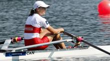 Tracy Cameron of Canada arrives at the finish line of the Women's Lightweight Single Sculls semi-final event at the Rowing World Championships in Bled, Slovenia, Thursday, Sep. 1, 2011. (Associated Press)
