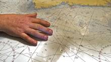 George Hopkins displays a map as talks about the decision to call off the search for the crew of the missing fishing boat Miss Ally in Woods Harbour, N.S. on Wednesday, Feb. 20, 2013. Hopkins's son Joel was one of the five young fishermen on the ill-fated vessel that capsized off the Nova Scotia coast. (Andrew Vaughan/THE CANADIAN PRESS)