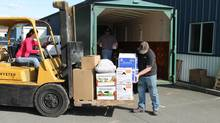 Shelly McGlothern operates a forklift as volunteers fill a container with donated goods for volunteers working at the Oso mudslide . (The Globe and Mail/Justin Giovannetti)