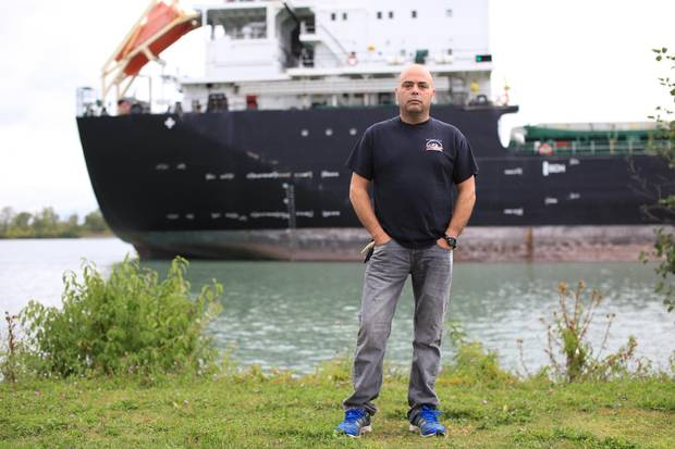 John Marsala, 45, stands beside the Welland Canal in St. Catharine's, Ont., near the drydocks where he used to work.