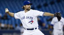 Toronto Blue Jays starting pitcher R.A. Dickey works against Chicago White Sox during first inning baseball action in Toronto on Thursday April 18, 2013. (Chris Young/THE CANADIAN PRESS)