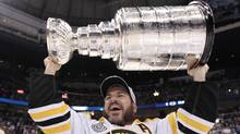 Boston Bruins Mark Recchi hoists the cup following his teams 4-0 win over the Vancouver Canucks in game 7 of NHL Stanley Cup Final hockey at Rogers Arena in Vancouver, Wednesday, June 15, 2011. (JONATHAN HAYWARD)