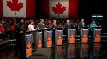 NDP leadership candidates Martin Singh, from left, Niki Ashton, Thomas Mulcair, Brian Topp, Nathan Cullen, Paul Dewar and Peggy Nash take part in a debate in Vancouver, B.C., on Sunday March 11, 2012. (CP)