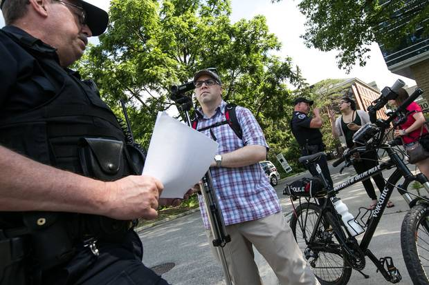 Adam Donaldson, the one-man staff of Guelph Politico, covers a police news conference and demonstration at the University of Guelph. He has launched a crowdfunding campaign on Patreon to support his work on the blog full-time.