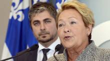 Drummondville PQ candidate Daniel Lebel, left, listens to party leader Pauline Marois in Drummondville on Thursday March 6, 2014. (Ryan Remiorz/THE CANADIAN PRESS)