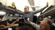 Dan Senor, senior national-security aide to U.S. Republican presidential candidate Mitt Romney, speaks to the press en route to Israel from London on Saturday. (JASON REED/Reuters)