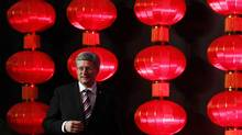 Canada's Prime Minister Stephen Harper arrives on stage to deliver a speech during a business dinner in Guangzhou February 10, 2012. (CHRIS WATTIE/REUTERS/CHRIS WATTIE/REUTERS)
