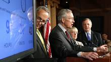 U.S. Senator Chuck Schumer (D-NY) (L-R), Senate Majority Leader Harry Reid (D-NV), Senator Patty Murray (D-WA) and Senator Dick Durbin (D-IL) stand with a clock counting down to a government shutdown at a news conference at the U.S. Capitol in Washington, September 30, 2013 (Jonathan Ernst/Reuters)