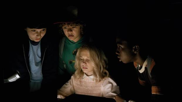 Millie Bobby Brown, Finn Wolfhard, Gaten Matarazzo and Caleb McLaughlin are seen in Netflix's Stranger Things.