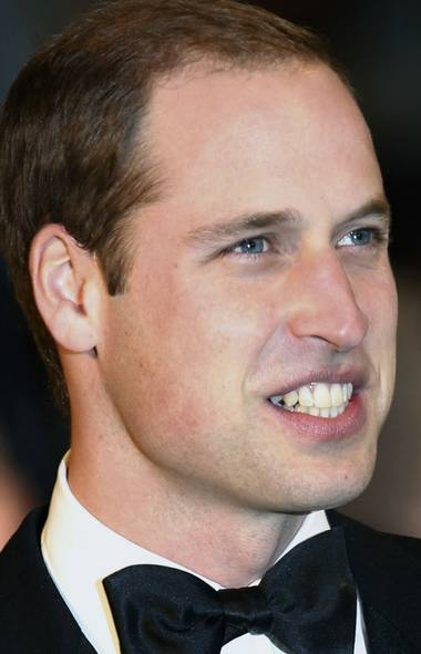 "Prince William. ""All the mothers have been looking at me [and saying,] 'Just you wait, just you wait. Long sleepless nights.'"" (People Magazine) (Luke MacGregor/Reuters)"