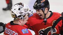 Calgary Flames' Jarome Iginla (R) celebrates his 500th goal with teammate goalie Miikka Kiprusoff during the third perio