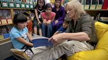 School teacher Kate Carlisle reads to students from the Sasdaze School in Bear Creek, Saskatchewan September 2, 2010. (John Lehmann/The Globe and Mail/John Lehmann/The Globe and Mail)
