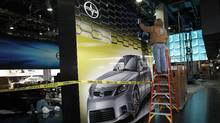 A worker polishes a wall at the Toyota Scion exhibit in preparation for the 2012 North American International Auto Show in Detroit on Thursday, Jan. 5, 2012. (Jeff Kowalsky/Bloomberg/Jeff Kowalsky/Bloomberg)