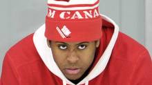 Canada forward Devante Smith-Pelly watches practice from the bench as Canada has the day off before playing against Finland for the bronze medal game at the IIHF World Junior Championships hockey action in Calgary, Alta., on Wednesday, Jan. 4, 2012. Smith-Pelly broke a bone in his foot early in the tournament. THE CANADIAN PRESS/Nathan Denette (Nathan Denette/CP)