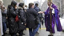 Cardinal Tom Collins greets worshippers at St. Michael's Cathedral after mass in Toronto Sunday. (J.P. MOCZULSKI/J.P. MOCZULSKI)