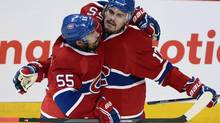 Montreal Canadiens left wing Rene Bourque celebrates his goal with teammate Francis Bouillon during second period in Game 5 of the NHL Eastern Conference final Stanley Cup playoff action Tuesday, May 27, 2014 in Montreal. (Ryan Remiorz/THE CANADIAN PRESS)