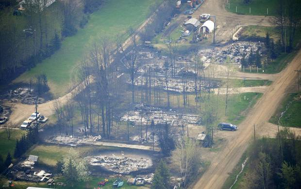 A row of houses lay burnt to the ground, on the outskirts of Slave Lake, Alta., on May 20, 2011.