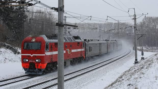 A locomotive travels on the Trans-Siberian railroad in the Kemerovo region of Siberia near Yashkino, Russia, on Friday, Oct. 24, 2014.
