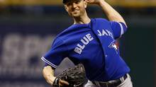Toronto Blue Jays starting pitcher J.A. Happ throws during the first inning of a baseball game against the Tampa Bay Rays Tuesday, May 7, 2013, in St. Petersburg, Fla. (MIKE CARLSON/AP)