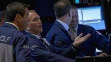 Traders work on the floor of the New York Stock Exchange August 25, 2014. (BRENDAN MCDERMID/REUTERS)