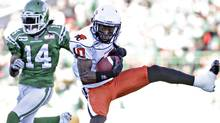 BC Lions wide receiver Kierrie Johnson catches the ball before being taken down by Saskatchewan Roughriders safety James Patrick during first half CFL football game in Regina, Saskatchewan October 16, 2011. REUTERS/David Stobbe (David Stobbe/Reuters)