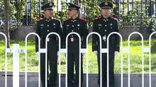 Chinese paramilitary policemen stand on duty in central Beijing ahead of the 205-member Central Committee's third plenum, Thursday, Nov. 7, 2013. Facing pressure to overhaul a worn-out growth model, China's leaders are promising dramatic changes at a weekend meeting that reform advocates hope will make history by unleashing a new wave of economic transformation. (Ng Han Guan/AP)