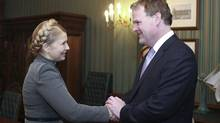 "Ukrainian opposition leader Yulia Tymoshenko greets Canada's Foreign Minister John Baird during their meeting in Kiev February 28, 2014. Ukraine's acting president called an emergency session of security chiefs on Friday to discuss events in Crimea and accused Russian forces of being involved in an ""escalation"" of events on the Black Sea peninsula."