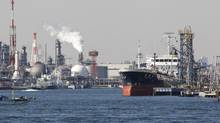 An oil tanker is moored at an oil loading platform adjacent to an oil refinery in Kawasaki, west of Tokyo, Monday, Feb. 20, 2012. Japan posted a record high trade deficit in January after its nuclear crisis shut down nearly all the nation's reactors for tougher checks, sending fuel imports surging. Exports were hurt by a strong yen and weak demand. (Koji Sasahara/Koji Sasahara/AP)
