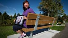 Carol Todd holds a photograph of her late daughter Amanda Todd in Port Coquitlam, B.C. (Darryl Dyck/The Canadian Press)
