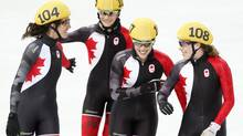 Canadian short-track women's relay team Marie-Eve Drolet, Jessica Hewitt, Valerie Maltais and Marianne St-Gelais celebrate their silver medal win in 3000-metre relay February 18, 2014 at the Sochi Winter Olympics. (John Lehmann/The Globe and Mail)