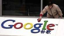 A Chinese worker cleans the Google logo at the Google China headquarters in Beijing, China, Monday, March 22, 2010. (Ng Han Guan/Ng Han Guan/AP)