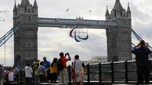 A Paralympic Games symbol hangs from Tower Bridge in London, Friday, Aug. 24, 2012. The London 2012 Paralympic Games starts on Wednesday, Aug. 29. (Sang Tan/AP)