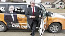 NDP Leader Brian Mason makes his way to a residential home to make his platform announcement in Edmonton March 28, 2012, for the upcoming Alberta provincial election. Voters in Alberta will go to the polls on Monday, April 23, 2012. (JASON FRANSON/THE CANADIAN PRESS)