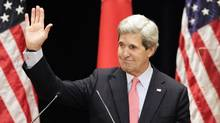 U.S. Secretary of State John Kerry waves after his lecture to students at Tokyo Institute of Technology on April 15, 2013. Mr. Kerry may soon get a barrage of letters from environmentalists concerned about pollution emanating from coal mines in southeastern British Columbia. (Junji Kurokawa/Reuters)